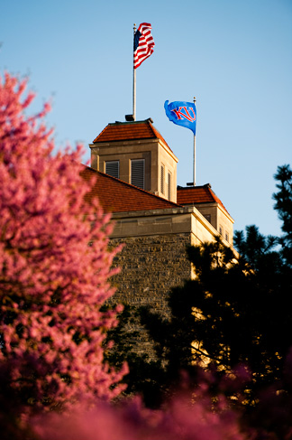 Fraser Hall flags in the fall