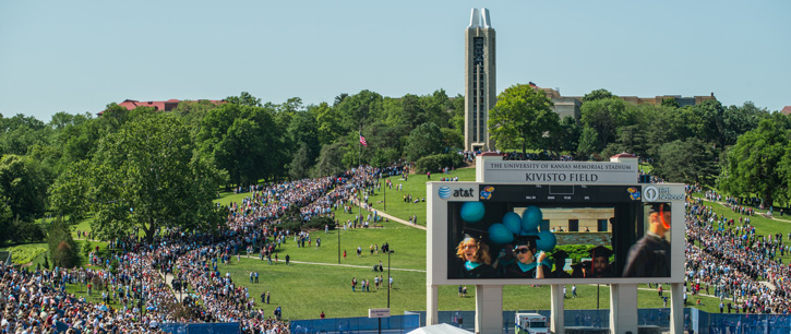 commencement ceremony with campanile