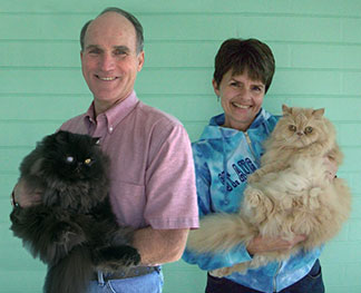 Keith and Laurie Tennant with their cats, Molly, left, and Milo.