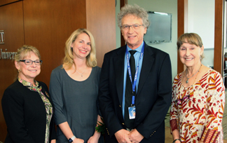 Cray Medical Research Foundation board executives Karen Seaberg, vice president; Melissa Huntington, president; and Susan Robbins, treasurer; meet with David Robbins, the incoming Cray professorship r